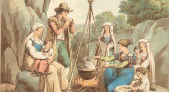 焚き火で食事をする百姓の一家