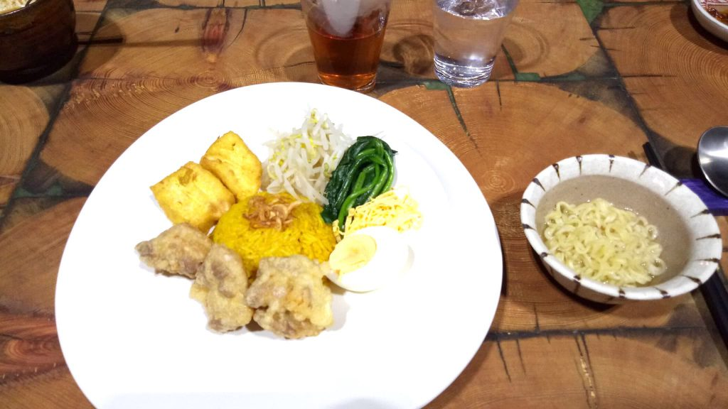 Nasi Tumpeng with vegetables, Fried Chicken, and Fried Tofu